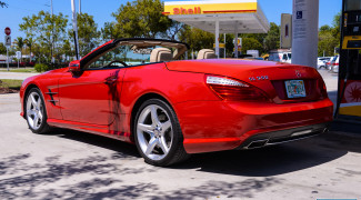 2013 Mercedes SL550 Red top down rear 3/4 gas station