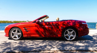 2013 Mercedes SL550 Red top down closer side profile ocean